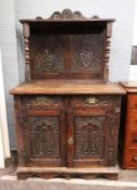 A late 17th century oak dwarf cupboard,