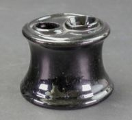 A Staffordshire 'Jackfield' style inkwell, circa 1760-70, of capstan form,
