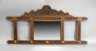 A carved oak hall wall mirror with five