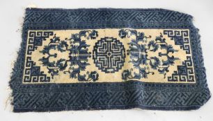 A Chinese rug, with a central medallion