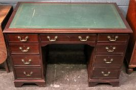 A reproduction George III style mahogany kneehole desk,