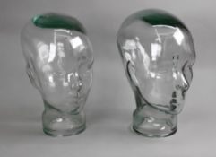 Two glass sculptures of heads, each 29cm