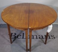 A George III mahogany 'D' end dining table with three extra leaves on tapering square supports,