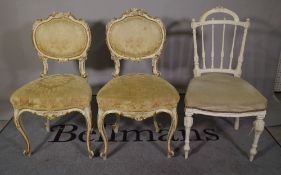 A set of four Louis XV style white painted and parcel gilt dining chairs and a Louis XVI style