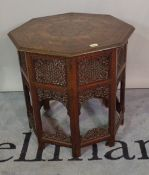 A late 19th/ early 20th century Eastern inlaid folding octagonal occasional table,