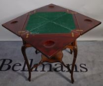 An Edwardian mahogany envelope card table, on cabriole supports, united by undertier,
