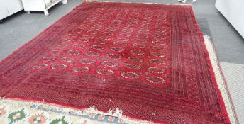 An Indian Bokhara carpet, red field, 358cm x 275cm.