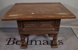 A 19th century and later oak dining table on carved pedestal base, 100cm wide x 74cm high.