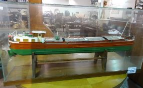 A large 20th century scratch built model of a French barge, Jocelyne, in a glass case,