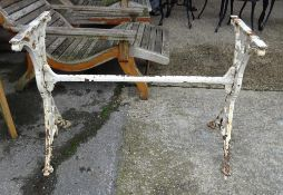 A late Victorian white painted cast iron table base, top lacking, 99cm wide x 69cm high.