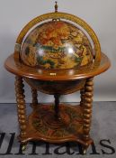 A 20th century drinks cabinet, formed as a globe, 75cm wide x 110cm high.