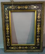 A 20th century painted frame with classical decoration, aperture 50cm x 70.