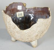 A post war studio pottery bowl, the exterior with a textured appearance beneath an irregular rim,