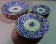 A set of 20th century Asian blue and white dining plates with textured decoration, (24).