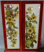 A pair of reverse painted flower pictures on glass in red velvet frames, 115cm x 40cm.
