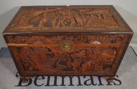 A 20th century Chinese carved hardwood trunk, 110cm wide x 70cm high, (a.f.).