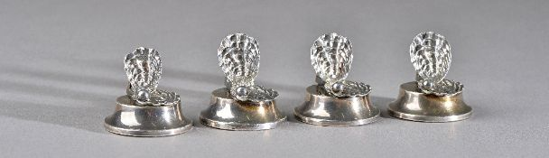 A set of four silver place name or menu stands, each formed as an open seashell,
