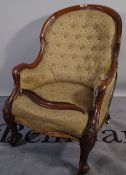 A Victorian mahogany button upholstered armchair on squat cabriole supports, 68cm x 112cm high.