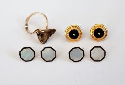 A set of four gold, mother-of-pearl and black enamelled octagonal dress buttons,