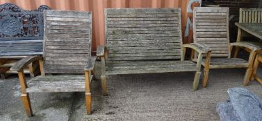 Garden furniture; a bench 135cm wide and a pair of matching armchairs, 76cm wide x 98cm high, (3).