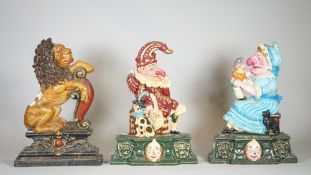 A group of three 20th century painted cast iron door stops, Punch & Judy and a lion, each 35cm high,