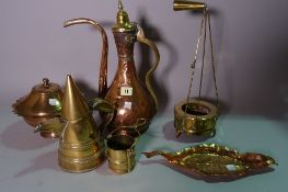 A group of copper and brass including a Turkish ewer, lidded pots,