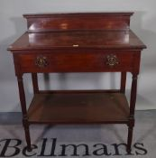 A late Victorian mahogany two tier side table on reeded tapering supports, 92cm wide x 106cm high.