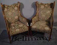 A pair of Edwardian mahogany line inlaid upholstered wing back armchairs, 57cm wide x 110cm high,
