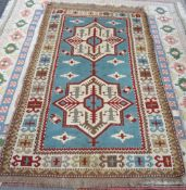 A modern Turkish rug, pale blue two medallions, of Caucasian design, 208cm x 130cm.