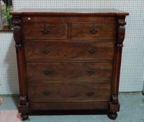 A Victorian mahogany chest of two short and three long graduated drawers on tapering bun feet,