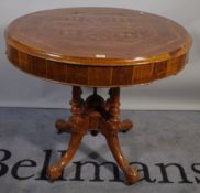 A Victorian specimen wood circular occasional table, on four outswept supports,