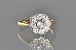 A gold and platinum, diamond set nine stone cluster ring,