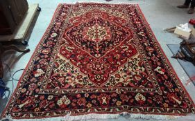 A Bakhtiari carpet, white ground with polychrome medallion and floral decoration,