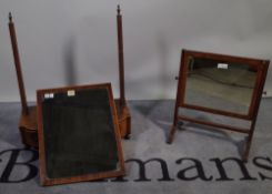 A Regency mahogany bowfront toilet mirror, 53cm wide and a smaller mirror, 41cm wide.