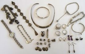 Mostly silver jewellery, comprising; a curb link charm bracelet, on a heart shaped clasp,