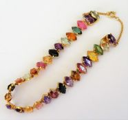 A gold and varicoloured gemstone bracelet,