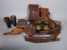 A group of collectables including binoculars, a gilt metal folding photo frame,