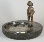 A 20th century bronze figure of a child, mounted on a dished granite base, 23cm high x 30cm wide.