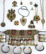 A collection of Asian jewellery, comprising; a necklace with pendant coins, five pendant necklaces,
