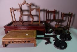 A quantity of 20th century Chinese hardwood stands of various sizes, (qty.).