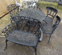 A 20th century black painted cast iron small garden bench,