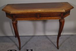 A 20th century oak console table on scroll supports, 123cm wide x 81cm high.