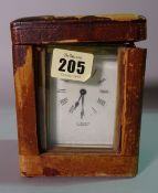 A 19th century brass cased carriage clock by 'J.BURN' in a leather case, 10cm wide x 15cm tall.