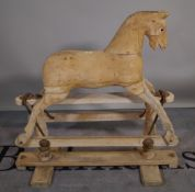 An early 20th century pine rocking horse, 80cm wide x 84cm high, (a.f.).