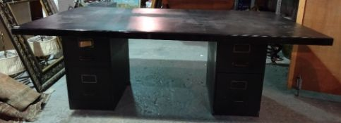 A 20th century black metal pedestal desk with four pedestal drawers, 199cm wide x 76cm high.