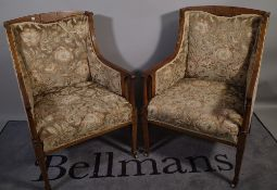 A pair of Edwardian mahogany line inlaid upholstered square back armchairs, 57cm wide x 89cm high,
