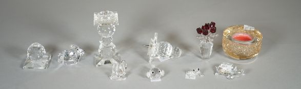Swarovski; a group of eight figures comprising, a puffer fish, a candle, a lion,