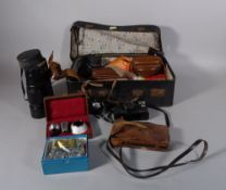 A quantity of early 20th century vintage cameras and accessories, within a leather suitcase,