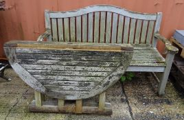 Garden furniture; a teak arched back garden bench,