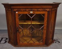A 20th century carved oak display cabinet with astragal glazed doors, 97cm wide x 74cm high.